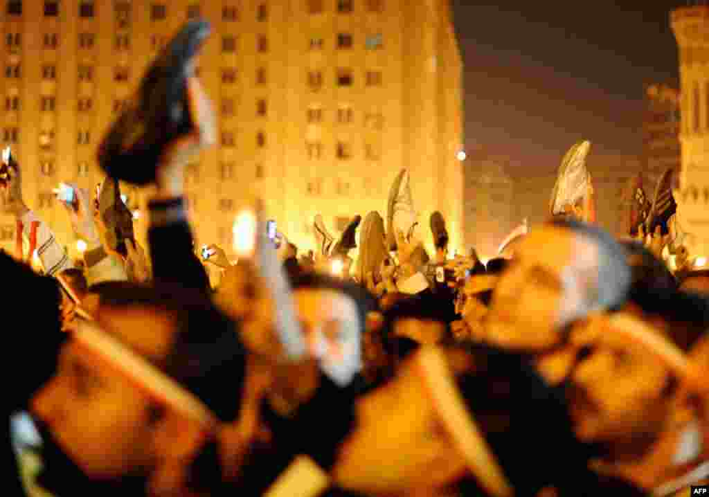 Protesters wave shoes in dismay as President Hosni Mubarak speaks to the nation. (Reuters/Dylan Martinez)