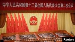 Các quan chức dự phiên họp toàn thể thứ hai của Đại hội Đại biểu Nhân dân Toàn quốc tại Đại Lễ đường Nhân dân ở Bắc Kinh, ngày 8 tháng 3, 2019.
