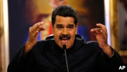 FILE - Venezuela's President Nicolas Maduro gives a news conference in Caracas, Venezuela, June 22, 2017. Maduro said a helicopter fired on Venezuela's Supreme Court June 27 in a confusing incident that he claimed was part of a conspiracy to destabilize his socialist government.