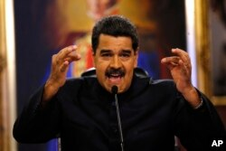 FILE - Venezuela's President Nicolas Maduro gives a news conference in Caracas, Venezuela, June 22, 2017.