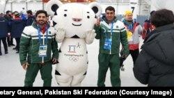 Muhammad Karim and Syed Human pose with Pyeongchang Olympics mascot.