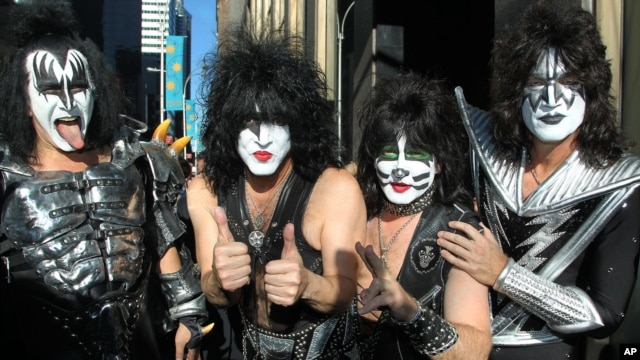"FILE - KISS band members from left: Gene Simmons, Paul Stanley, Eric Singer, Tommy Thayer arrive at SiriusXM offices to promote their latest release, ""Monster,"" in New York."
