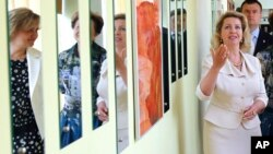 FILE - Svetlana Medvedev, wife of then-Russian President Dmitry Medvedev, visits a center for victims of domestic violence in Moscow, July 7, 2011.