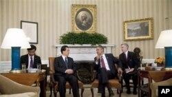 奥巴马和胡锦涛在白宫椭圆形办公室会谈