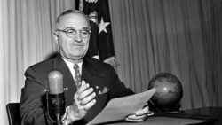 President Harry Truman at the White House, September 1st, 1945, preparing to broadcast a message on the official surrender of Japan