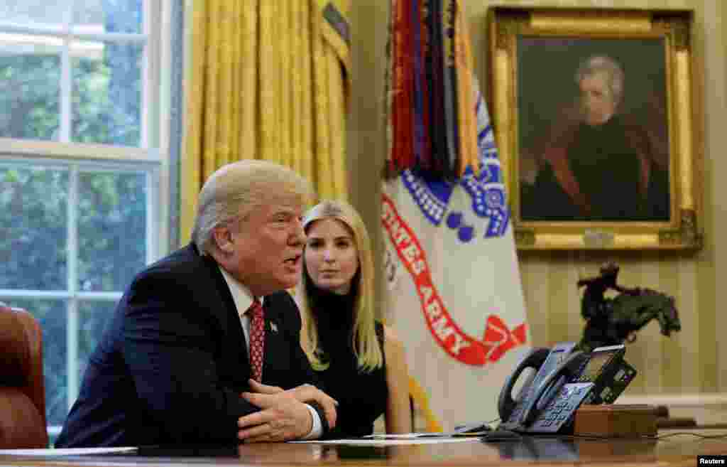 U.S. President Donald Trump and his daughter Ivanka hold a video conference call with Commander Peggy Whitson and Flight Engineer Jack Fischer of NASA on the International Space Station from the Oval Office of the White House in Washington, U.S.