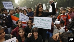 Indian students carrying placards shout slogans against last week's gang-rape as they protest in central New Delhi, India, Dec. 24, 2012.