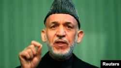 Afghan President Hamid Karzai speaks during a news conference in Kabul, Jan. 25, 2014.
