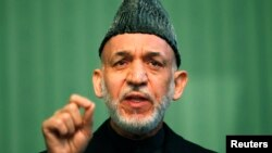 FILE - Afghan President Hamid Karzai speaks during a news conference in Kabul, Jan. 25, 2014.