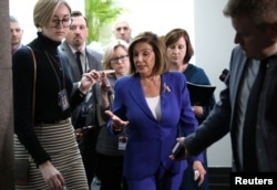 FILE - House Speaker Nancy Pelosi answers questions from reporters on Capitol Hill, in Washington, Jan. 8, 2020.