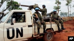 FILE - U.N. peacekeepers patrol outside Bria, Central African Republic, May 26, 2017.