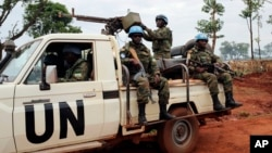 FILE - In this photo taken May 26, 2017, U.N. peacekeepers patrol outside Bria, Central African Republic. The United Nations said at the time that about 300 people had been killed and 200 wounded in the previous two weeks in Bria and a handful of other towns.