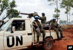 In this photo taken May 26, 2017, U.N. peacekeepers patrol outside Bria, Central African Republic. The United Nations said at the time that about 300 people had been killed and 200 wounded in the previous two weeks in Bria and a handful of other towns.