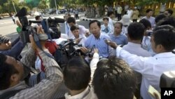Rong Chhun, rear center, head of the Cambodian Confederation of Unions gives a press conference on a street in Phnom Penh, file photo.
