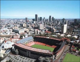 Ellis Park, as it appears today, with the city of Johannesburg in the background … In 1995, 65,000 people packed the stadium to see the South Africa rugby team win the rugby World Cup