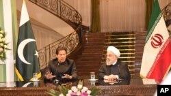 وزیر اعظم عمران خان اور ایران کے صدر حسن روحانی۔