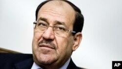 지난 23일 바그다드에서 존 케리 미국 국무장관의 회담에 참석한 누리 알말리키 이라크 총리.