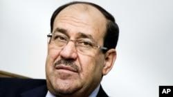 2014年6月23日伊拉克總理馬利基在巴格達會見美國國務卿克里