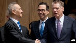 Treasury Secretary Steve Mnuchin, center, and United States Trade Representative Robert Lighthizer, right, speak with Chinese Vice Premier Liu He, left, as he leaves the Office of the United States Trade Representative in Washington, Friday, May 10, 2019.
