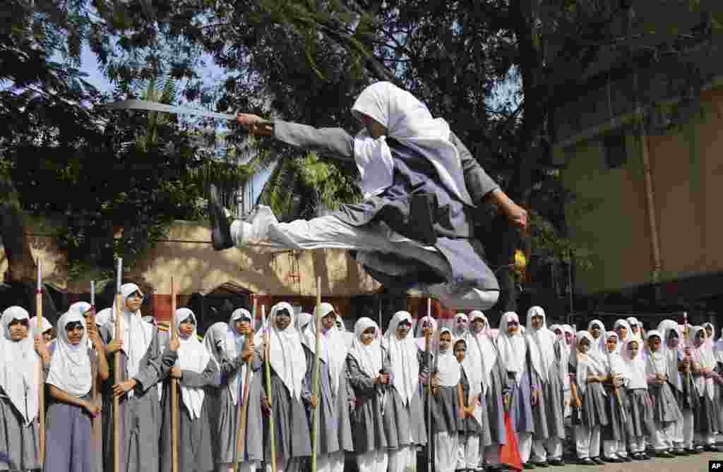 An Indian Muslim girl performs martial arts during a function to mark International Women's Day at a school in Hyderabad. International Women's Day will be marked on March 8.
