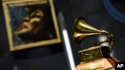 "Ella Fitzgerald's Grammy for best female vocal performance, awarded in 1958, is displayed at a sneak preview of ""Ella at 100: Celebrating the Artistry of Ella Fitzgerald"" at The Grammy Museum at L.A. Live, April 24, 2017, in Los Angeles."
