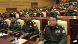 Burmese military representatives attend a regular session of parliament in Naypyitaw, Burma, October 18, 2012.