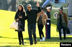 FILE - President Barack Obama waves as he walks with first lady Michelle Obama (R) and their daughters Malia (L) and Sasha on the South Lawn of the White House, Jan. 3, 2016. The Obama family returned from Hawaii, the president's home state,