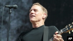 "FILE - Singer-songwriter Bryan Adams performs in concert during his ""Reckless - 30th Anniversary Tour 2015"" at the Delaware State Fair, July 28, 2015."