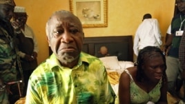 Gbagbo and wife Simone sit in a room at Hotel Golf after they were arrested, Abidjan, April 11, 2011.