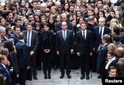 From left, French Minister for Higher Education and Research Thierry Mandon, French Education Minister Najat Vallaud-Belkacem, French President Francois Hollande and French Prime Minister Manuel Valls observe a minute of silence at the Sorbonne University in Paris, Nov. 16, 2015.