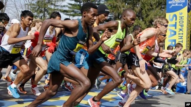 Elite men runners leave the start line in the 118th running of the Boston Marathon Monday, April 21, 2014 in Hopkinton, Massachusetts.