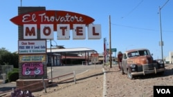 A motel is an inexpensive hotel that people usually stay in when traveling long distances by car.