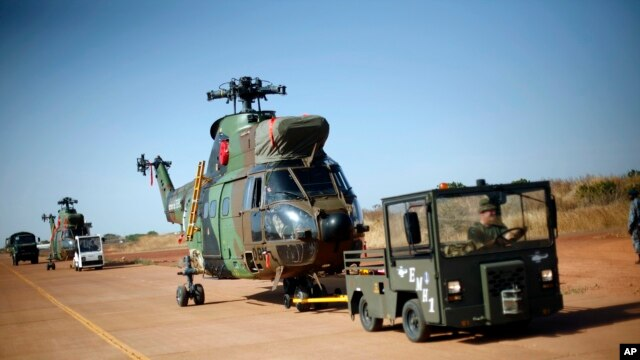 French helicopters are towed to the military side of  Bamako's airport, Mali, January 16, 2013.