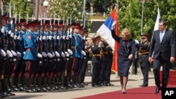 Valentina Matviyenko, speaker of the Federation Council, Russian parliament's upper chamber, center, reviews a guard of honour with Milorad Dodik, President of the Republic of Srpska in the Bosnian town of Banja Luka, April 24, 2018.