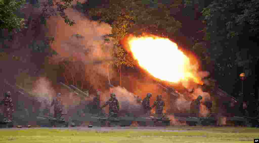Army troops fire their 105mm Howitzer to welcome President Rodrigo Duterte as he arrives for the turnover of command ceremony for the new Army Chief Maj.Gen. Rolando Joselito Bautista Thursday, Oct. 5, 2017 in Fort Bonifacio in suburban Taguig city east of Manila, Philippines.