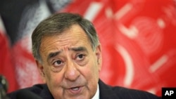 U.S. Defense Secretary Leon Panetta speaks during a news conference after meeting with troops and Afghan President Hamid Karzai and other Afghan officials, at the airport in Kabul, March 15, 2012.