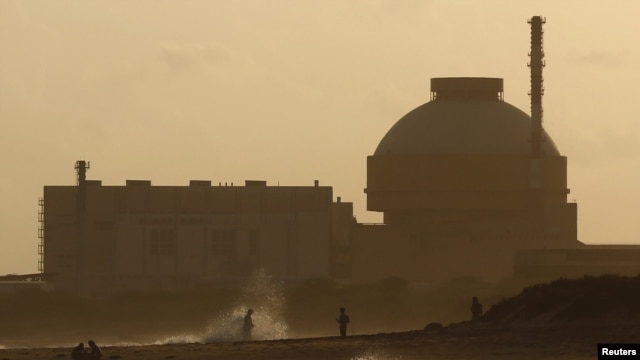 FILE - Police patrol on a beach near Kudankulam nuclear power plant project in the southern Indian state of Tamil Nadu, September 12, 2012.