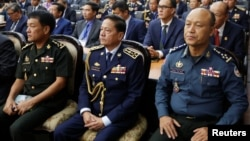 Cambodia's national police chief Neth Savoeun (C) attends an event at the Ministry of Interior in Phnom Penh, on Feb. 14, 2019. Reuters' recent investigation revealed that he and his family had obtained or applied for Cypriot nationality using an investment-to-citizenship scheme.