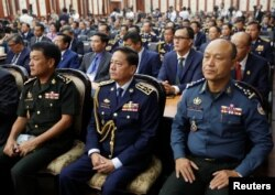 Cambodia's national police chief Neth Savoeun, centre, in full uniform at a Ministry of Interior event in Phnom Penh in February. REUTERS/Stringer