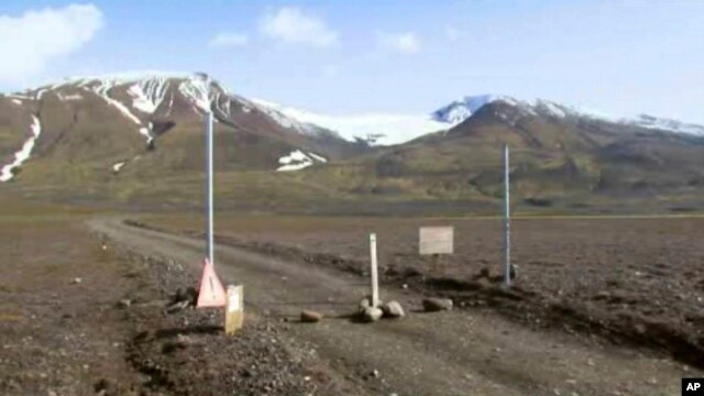Image taken from video of a sign posted on the road next to Bardarbunga, a subglacial stratovolcano located under Iceland's largest glacier, August 19, 2014.