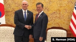 U.S. Vice President Mike Pence greets South Korean President Moon Jae-in in the Blue House, the executive office and official residence, Feb. 8, 2018 in Seoul, South Korea.