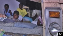 Haitian family sleeping outside after earthquake