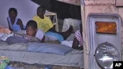 Haitian family sleeping outside after earthquake
