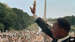 FILE - Martin Luther King Jr. waves to a rally on the National Mall.