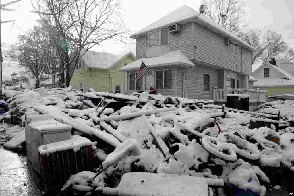 A pile of garbage in the street is covered with snow in the New Dorp section of Staten Island, New York, November 8, 2012.
