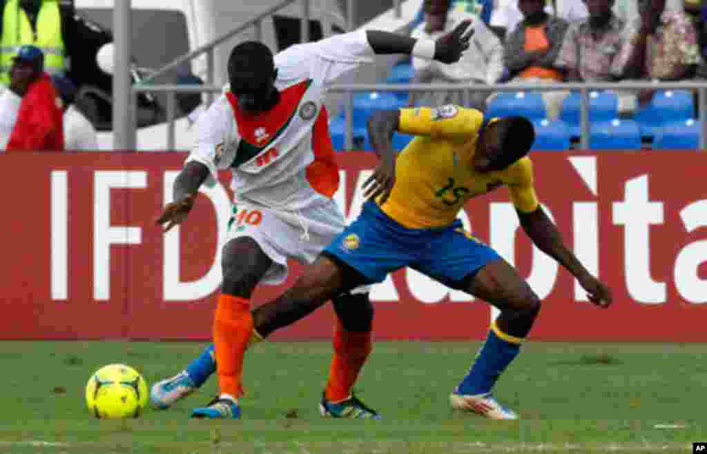 Gabon's Biyong Poko fights for the ball with Niger's Boubacar Djibo during their African Nations Cup Group C soccer match at Stade De L'Amitie Stadium in Libreville