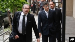 State prosecutors Jose Carlos Blat, left, Cassio Roberto Conserino, center, and Fernando Henrique de Moraes Araujo, responsible for the charges against Brazil's former President Luiz Inacio Lula da Silva, arrive for a press conference at the Attorneys Gen