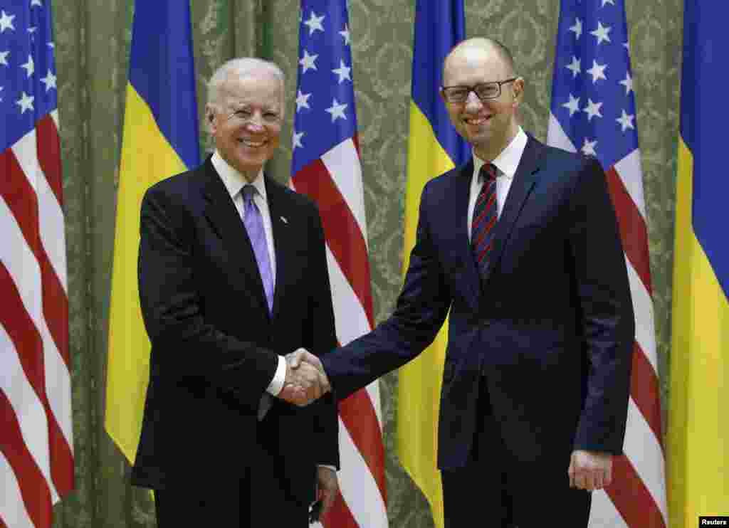 U.S. Vice President Joe Biden shakes hands with Ukrainian Prime Minister Arseniy Yatsenyuk during their meeting in Kyiv, November 21, 2014.