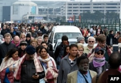 Passengers are evacuated from Brussels airport, on March 22, 2016 in Zaventem, after at least 13 people were killed and 35 injured as twin blasts rocked the main terminal of Brussels airport.