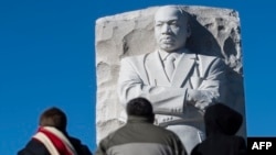 People visit the Martin Luther King Jr. Memorial in Washington, DC on Martin Luther King Day on January 21, 2019. (Photo by Andrew CABALLERO-REYNOLDS / AFP)